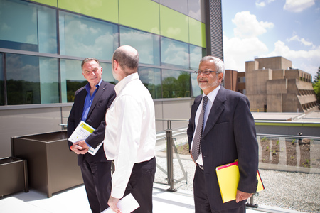 This is a picture of the Minister of Environment being shown the new environment building, E3. From left to right, the Minister of Environment, Professor Lewis, and Professor Nathwani.