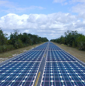 This is a picture of an electric highway that contains solar panels along the road surface.